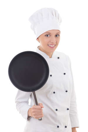 teflon: portrait of young woman in chef uniform with frying pan isolated on white background Stock Photo