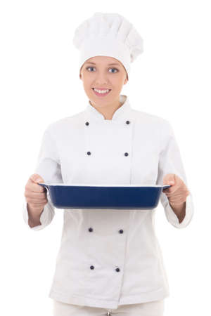 happy young woman in chef uniform holding ceramic platter isolated on white background photo