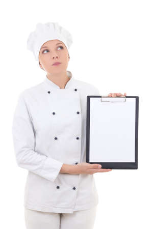 dreaming woman in chef uniform holding clipboard with copy space isolated on white background photo