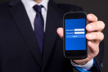 modern mobile phone with login screen in business man hand photo