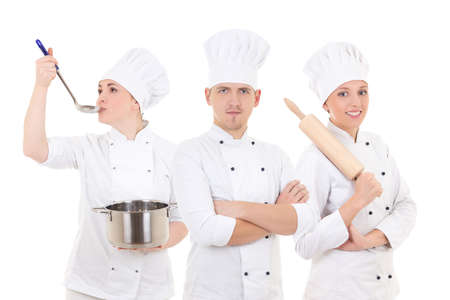 catering service: cooking concept - three young chefs isolated on white background Stock Photo