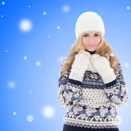 portrait of young beautiful girl in winter clothes over winter background photo