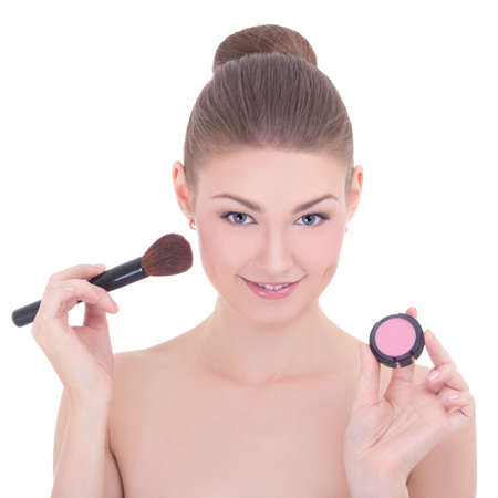 portrait of young beautiful woman with make up brush and rouge or powder isolated on white background photo