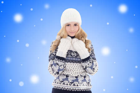 portrait of young lovely beautiful girl in winter clothes over winter background photo