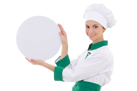 young chef woman in uniform holding big  empty plate isolated on white background photo