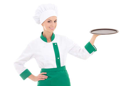 young chef woman in uniform holding big  empty tray isolated on white background photo