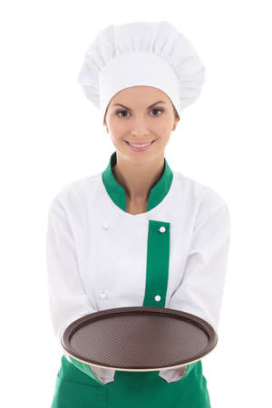 young chef woman in uniform showing empty plate isolated on white background photo