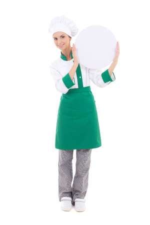 young chef woman in uniform holding big  empty plate with copyspace isolated on white background photo