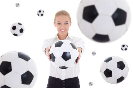 beautiful business woman holding soccer ball over white background with flying leather balls photo