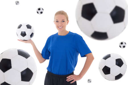 female soccer player in blue uniform over white background with flying leather balls photo