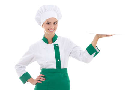 young chef woman in uniform with empty plate isolated on white background photo