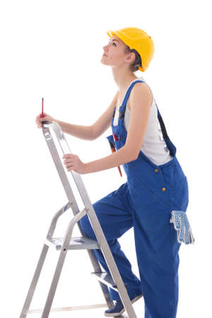 young woman builder in blue coveralls with screwdriver on ladder isolated on white background