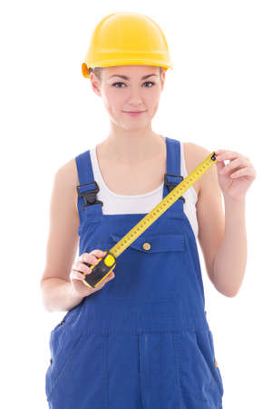 woman builder in blue coveralls holding measure tape isolated on white background photo