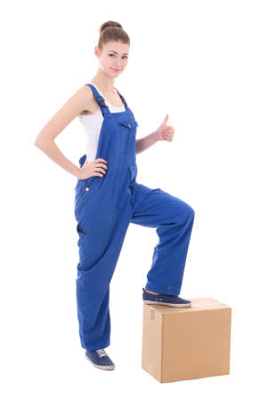 studio happy overall: moving day concept - young attractive woman in blue coveralls with cardboard box isolated on white background