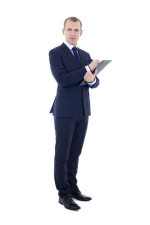 full length portrait of young businessman in suit with pen and clipboard isolated on white background photo