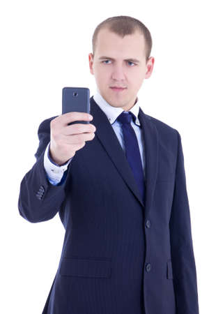 business man taking photos with mobile camera isolated on white background photo