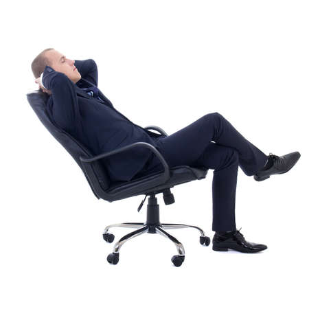executive chair: happy business man sitting on office chair isolated on white background