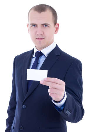 young businessman in suit holding business card isolated on white background photo