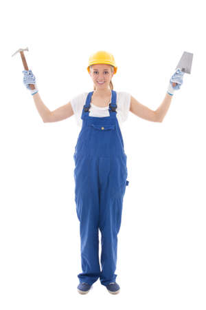 woman in blue builder uniform with trowel and hammer isolated on white background photo