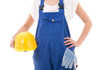 yellow safety helmet in builders hands isolated on white background photo