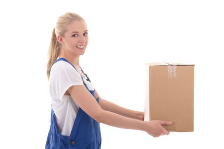 mailmen: delivery concept - happy woman in blue workwear giving cardboard box isolated on white background Stock Photo