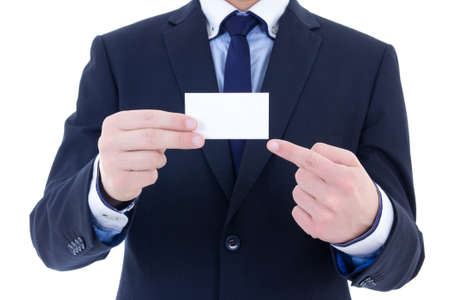 blank business card in a businessmans hand isolated on white background photo