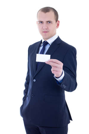 young handsome businessman in suit holding business card isolated on white background photo