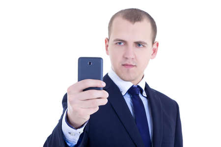 business man taking selfie photos with mobile camera isolated on white background photo