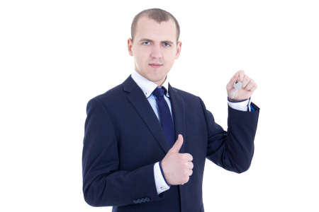 young business man with key in hand thumbs up isolated on white background photo
