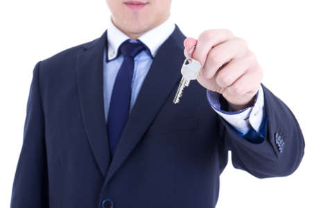 key in male real estate agent hand isolated on white background photo