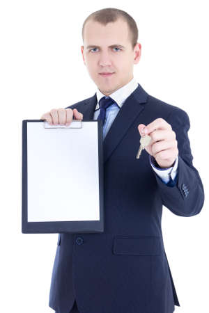 young man real estate agent holding key and blank clipboard isolated on white background photo