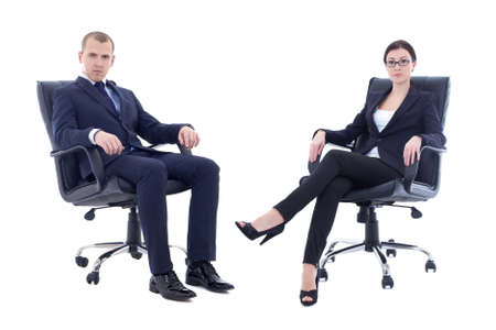 director chair: young man and beautiful woman in business suits sitting on office chairs isolated on white background