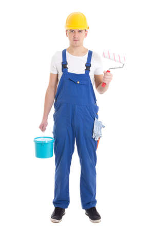 painter and decorator: young man painter in blue coveralls isolated on white background