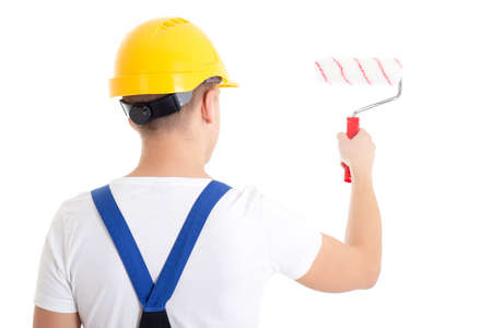 painter and decorator: back view of man painter in workwear with paintbrush isolated on white background