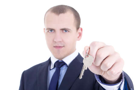 metal key in male real estate agent hand isolated on white background photo