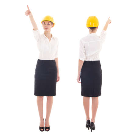 front and rear view of business woman architect in yellow builder helmet pointing at something isolated on white background photo