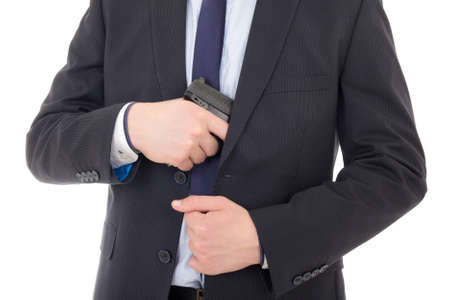 man hiding gun isolated on white background photo