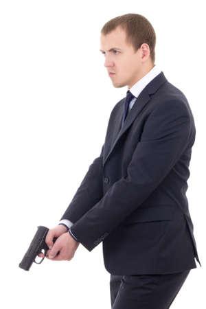 guardaespaldas: polic�a o guardia en traje de negocios con pistola aislado en fondo blanco