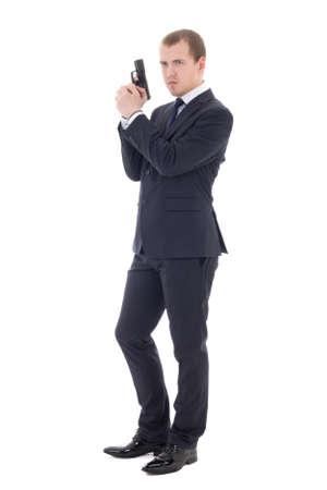 白い背景で隔離の銃を持つポーズ ビジネス スーツを着た男