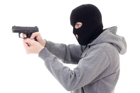 assasin: man in mask shooting with gun isolated on white background
