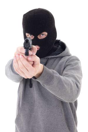 assasin: burglar or terrorist in black mask shooting with gun isolated on white background