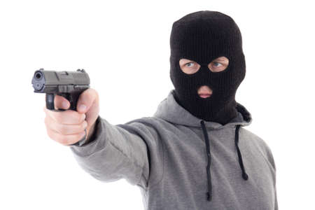 assasin: burglar or terrorist in mask aiming with gun isolated on white background Stock Photo