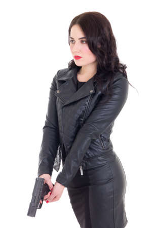 leather coat: portrait of sexy woman in black with gun isolated on white background