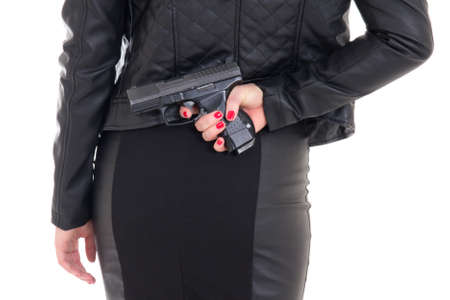 sexy woman hiding gun behind her back isolated on white background photo
