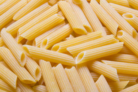 rotini: close up of yellow raw italian pasta