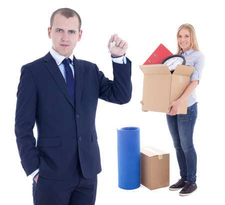 key box: moving day concept - businessman real estate agent giving key to woman with cardboard box isolated on white background Stock Photo