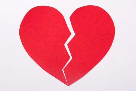 broken relationship: love concept - red paper broken heart over white background Stock Photo
