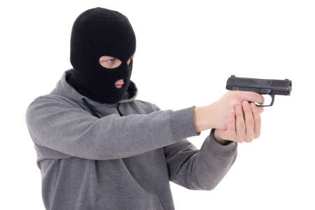 mugger: man in black mask shooting with gun isolated on white background