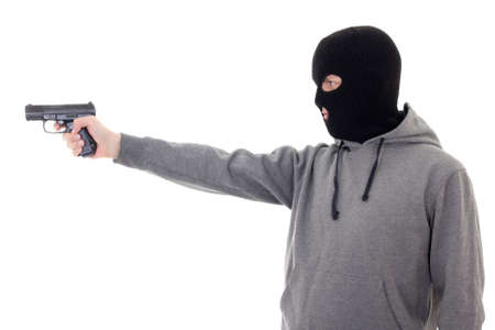 assasin: profile view of man in mask aiming with gun isolated on white background