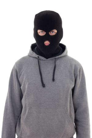 derecho penal: hombre criminal en la m�scara aislada sobre fondo blanco